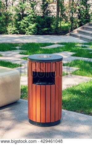 Metallic Trash Bin On The Street, Outdoors. Stainless Steel Litter Bin With Wood Paneling, With A As