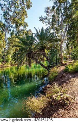 Israel. The Jordan River is the most famous river in the world. Jordan is the place of the baptism of Christ. The warm winter sunny day. Wonderful walk along the river