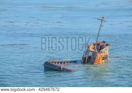 Ship Wrecked Fishing Vessel On The Rocks Of Estero Bluffs State Park In San Luis Obispo County, Cali