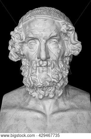 Gypsum copy of ancient statue Homer head on dark textured background. Plaster sculpture man face