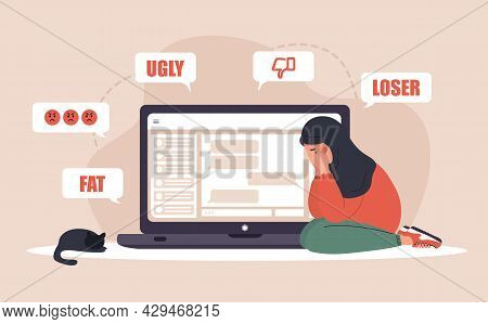 Cyber Bullying. Sad Arab Woman With Laptop Receiving Pop Up Messages. Online Abuse Concept. Teenager