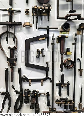 Many Tools For Repairing Motorcycles Hanging On Wall In Workshop. Set Craftsman Tool , Mechanical To