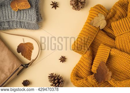 Top View Photo Of Yellow Sweater Grey Knitted Scarf Leather Handbag Autumn Brown Leafage Anise And P