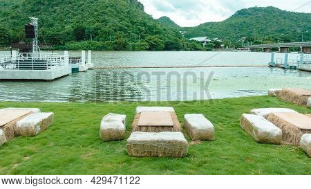 Seats And Tables Made From Straw Bales For Event And Party Laid On Lawn Yard. Straws Stubble Decorat