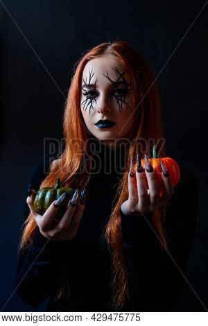 Halloween Witch Woman With Long Nails And Make-up.