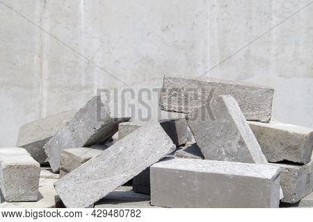 A Pile Of Cement Type Bricks. Solid Brick Is Used For Construction. Lots Of Loose Concrete Bricks At