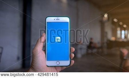 Chiang Mai, Thailand: June 16, 2021: Linkedin Logo On Smartphone Screen. Women Holds Apple Iphone Wi