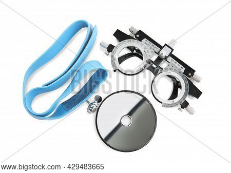 Trial Frame And Head Mirror On White Background, Top View. Ophthalmologist Tools