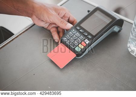 Man Put The Red Credit Card Into A Reader, Close Up