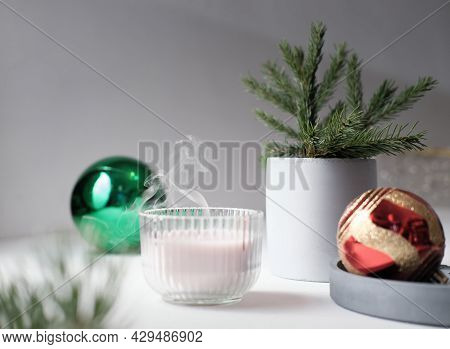 Hygge And Aromatherapy Concept, Branch Of Pine In A Concrete Vase And Pink Scented Soy Candle Next T