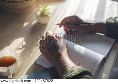 Planner Plan Schedule Calendar And Reminder Agenda, Work Online At Home. Man Hand Writing Planning D