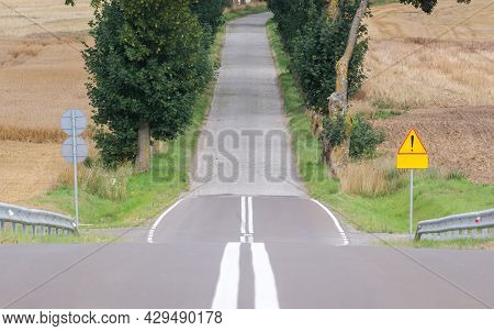 Local Route - Asphalt And Pavement Among Farmland
