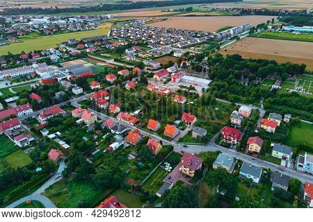 Small Town In Europe, Aerial View. Residential Buildings And Streets In Small City