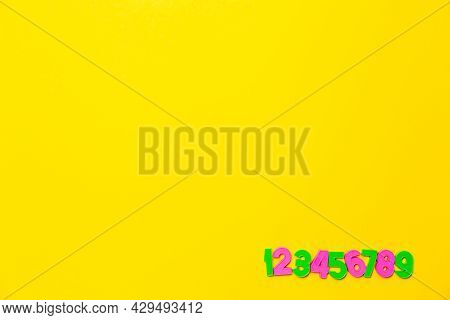 Numbers Set 1 2 3 4 5 6 7 8 9. Copy Space. Colorful Plastic Numerals Isolated On Yellow Background.