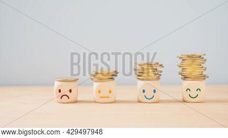 Emotion Face On  Stack Of Coins, Saving Money, Deposit, Wealthy, Profit, Cash For Health Budget Or I