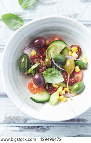 Simple Salad With Green And Kalamata Olives, Cucumber, Cherry And Marinated Tomatoes, Capers And Jal