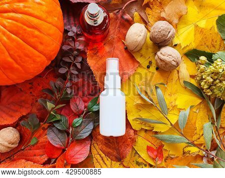 White Cosmetic Spray Bottle, Red Perfume Bottle, Pumpkin, Magic Lights And Bright Autumn Leaves. Nat