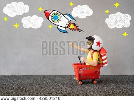 Happy Child Pretend To Be Astronaut. Kid Playing Outdoor. Creative And Children Imagination Concept