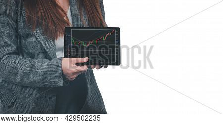 A Young Businesswoman Holds A Tablet With A Graph Showing The Ups And Downs Of Her Stock. Concept Of