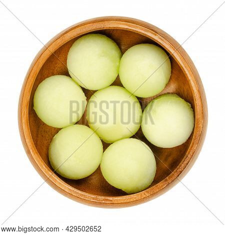 Galia Melon Balls, In A Wooden Bowl. Freshly Cut Out With A Melon Baller, Ready-to-eat Pieces Of A R