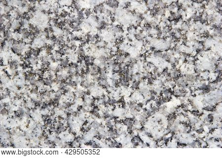 Gray Granite With Yellow-white Inclusions. Background Granite Texture, Top View.