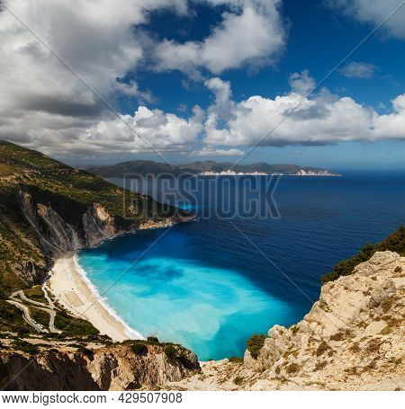 A Top Panoramic View At Myrtos Beach And Fantastic Turquoise And Blue Ionian Sea Water. Aerial View,