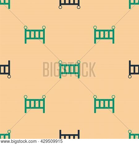 Green And Black Baby Crib Cradle Bed Icon Isolated Seamless Pattern On Beige Background. Vector