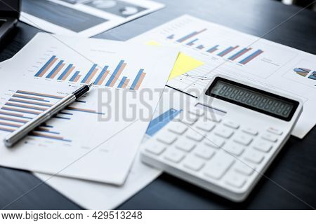 Businessman's Desk The Sales Manager's Desk Has A White Sheet Of Monthly Sales Data, A Salesperson,