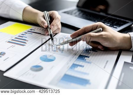 Two Businessmen Pointed To The Material For The Meeting, Working Together To Plan To Develop And Sol