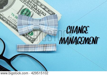Tie, Banknotes, Colored Paper With The Words Change Management