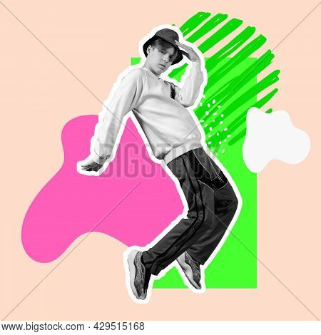 One Young Bw Man In Casual Clothes And Hat Dancing Over Bright Splashes On Pastel Background. Minima