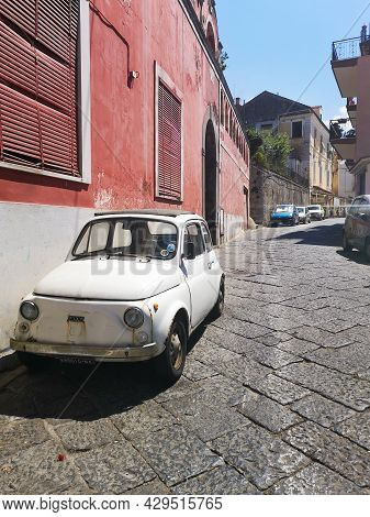 Sorrento, Italy - August 26 2020: Old Vintage Rusty Fiat 500 Standing At City Streets