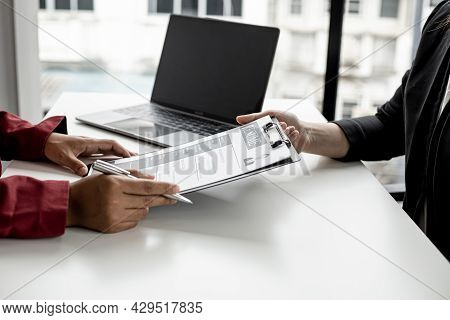 The Job Applicant Is Submitting A Resume To The Manager For A Job Interview. The Concept Of A Job In
