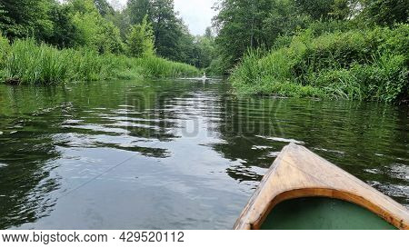 The Wooden Nose Of A Kayak On The Background Of A River In The Middle Of The Forest. Extreme Kayakin