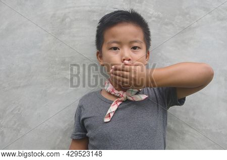 Boy Covering His Mouth - Asian Boy Covering His Mouth With His Hand, Doesn't Like It, Doesn't Eat, D