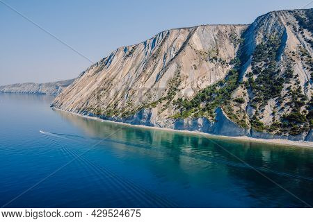 Coastline With Blue Sea And Highest Cliff With Pine Trees. Summer Day On Sea And Boat. Aerial View