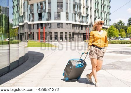 Traveler Suitcase, Woman Carrying A Suitcase In A Travel Location On Holidays Trip With Lens Flare T