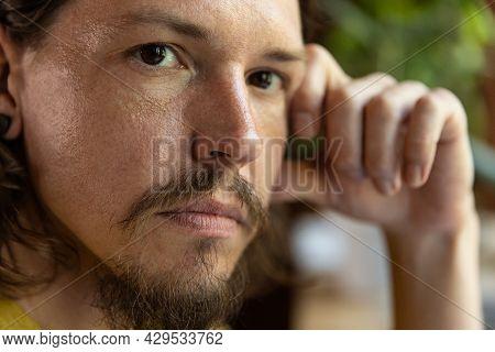 Close-up Portrait Of Young Caucasian Man, Photographer, Cameraman With Professional Camera, Equipmen