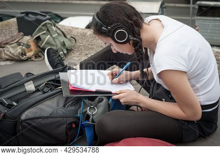 Sound Director Technician With Headset Writing Sound Recorder Audio Script