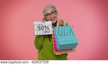 Senior Granny Woman Showing Shopping Bags And Up To 50 Percent Off Inscriptions Banner Text. Black F