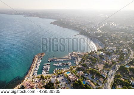 Drone Point Of View Cabo Roig Harbor With Moored Docked Luxury Nautical Vessel In Mediterranean Sea
