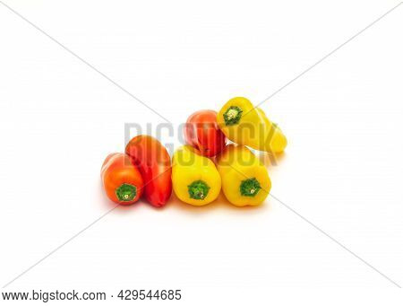 Pile Of Colorful Yellow And Red Mini Sweet Peppers Snack Isolate On White
