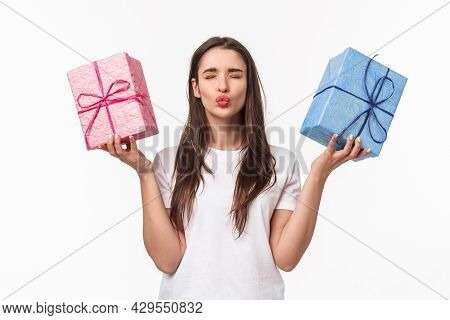 Celebration, Holidays And Presents Concept. Portrait Of Lovely Coquettish Young Woman In T-shirt, Fo