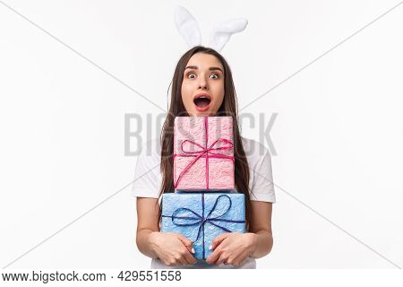 Celebration, Holidays And Presents Concept. Portrait Of Amused Young Beautiful Woman With Rabbit Ear