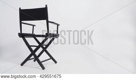 Sight Back Of Black Director Chair Use In Video Production Or Movie Industry On White Background.