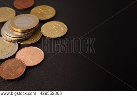 Euro And Euro Cent Coins On A Black Table.