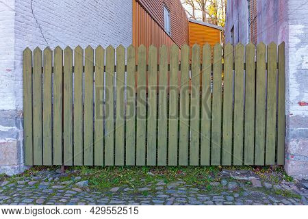 Old Green Wood Picket Fence In Norway