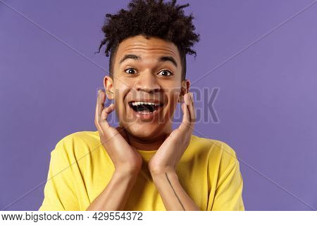 Close-up Portrait Of Extremely Happy, Enthusiastic Young Man Hear Fantastic News, Looking Surprised
