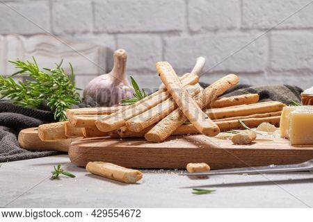 Traditional Italian Breadsticks Grissini With Rosemary, Parmesan Cheese, Olive Oil, Garlic And Salt