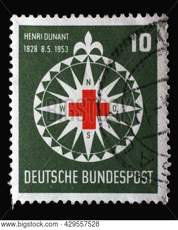 ZAGREB, CROATIA - SEPTEMBER 11, 2014: Stamp printed in Germany, shows symbol of the Red Cross in a stylized wind rose, circa 1953
